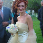 abito da sposa silvia.la parte alta del corpino è drappeggiato con del tulle. raso di seta.